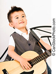 Young Boy Jamming Full Size Guitar Gritting Teeth Playing...