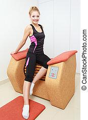 Girl using relax massage equipment