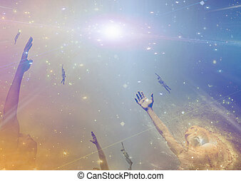 People soaring toward light amongst stars