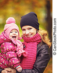 Mom and baby daughter for walk in autumn - Mom and baby...