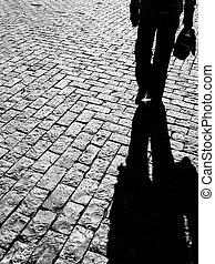 walking in shadow - vision of a silhouette walking on a...