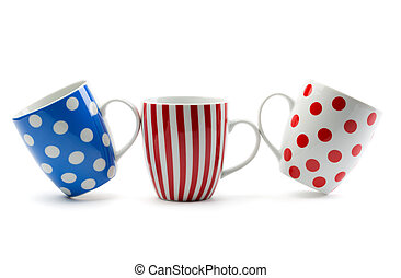 Three porcelain cup with stripes and dots. Isolate on white.