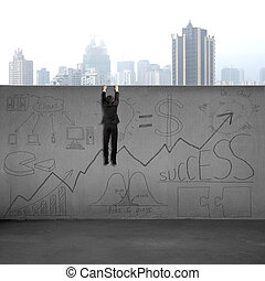 Man climbing over wall with business doodles and city view...