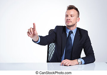 business man pushes imaginary button - young business man...