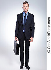 business man with briefcase - portrait of a young business...