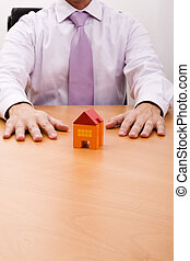 New house - businessman selling a new house at his office...