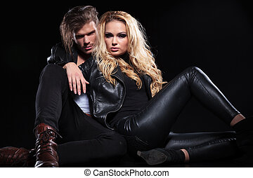 young couple relaxing on the floor