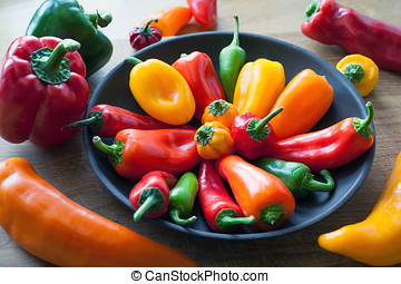 Sweet and Hot Peppers in a Kitchen Bowl - A mix of sweet and...