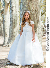 Girl in first communion dress.