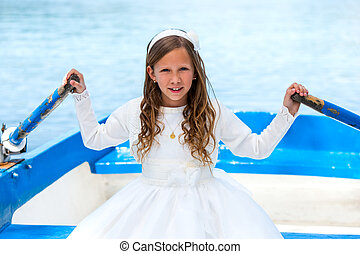 Girl in white dress rowing on lake.