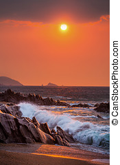 Slapton Sands Sunrise - Sunrise view of waves crashing onto...