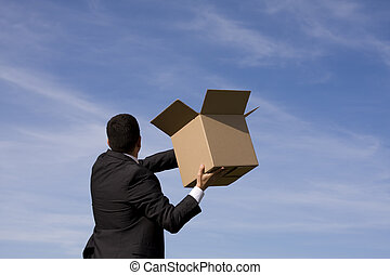 Business deliver - businessman with an open box to the sky