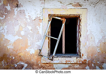 Detail of old damaged window and textured cracked wall -...