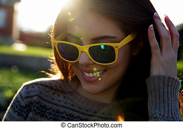 Closeup portrait of a happy fashionable woman