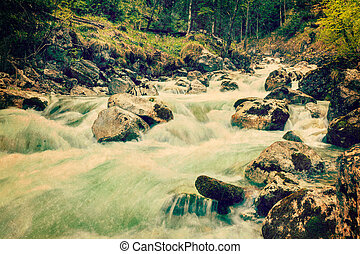 Vintage retro hipster style travel image of cascade of...