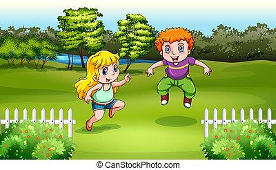 Two Caucasian kids dancing