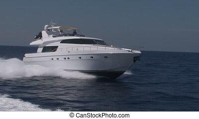 Luxury boat navigating in the mediterranean sea