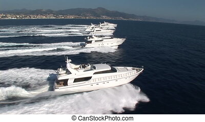Aerial view of luxury yacht fleet