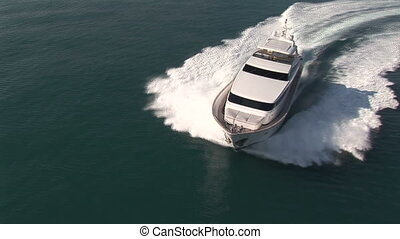 Aerial view of luxury yacht navigating in open sea