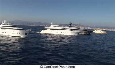 Aerial view of luxury yacht fleet - Aerial view of fleet of...