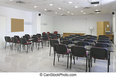Classroom interior with projector, screen and chairs