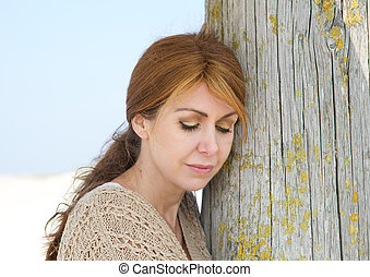 Close up portrait of a middle aged woman looking sad