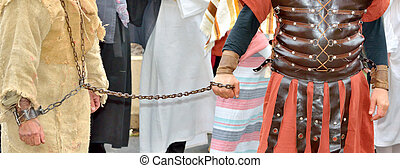 roman soldier and handcuffed prisoner - Jesus Christ chained...