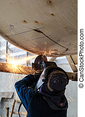 Welding and Grinding - Welding and grinding sparks of...