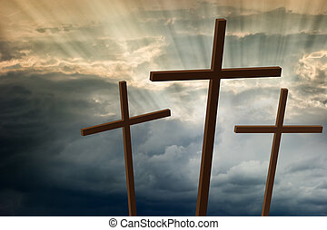Three wooden crosses stand against a dramatic evening sky...