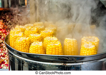 boiled corn - steamed boiled yellow corn in the tank