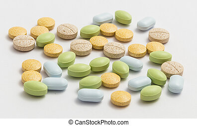 tablets - different colored pills in the pack closeup