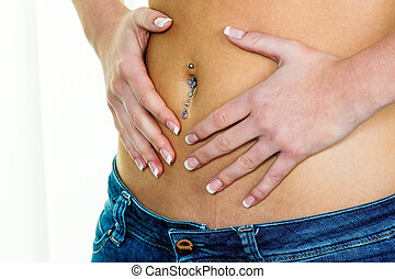 woman hands on belly - a woman has abdominal pain or stomach...