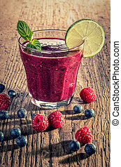 Red fruit smoothie made from wild berries