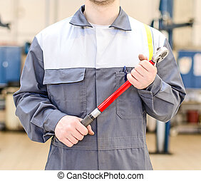 Mechanic with torque wrench at auto repair shop
