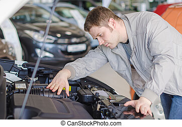 Man examining new car at the dealership