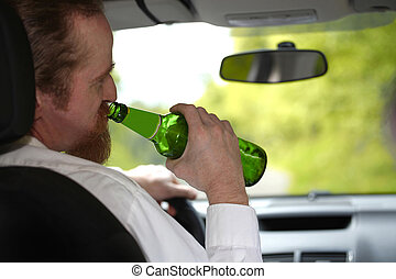 Drunk man in car with a bottle beer