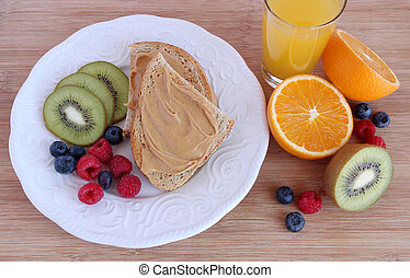 Peanut butter toast with fruit - Rye bread toast with peanut...