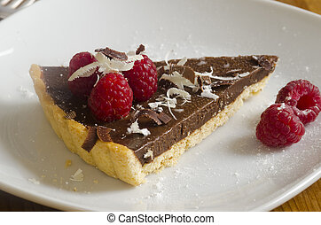 Chocolate tart - Piece of chocolate tart topped with...
