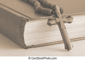 book with a cross - Old book with a cross on white...