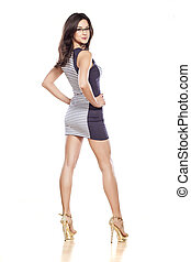 short dress - side view of young pretty woman in a short...