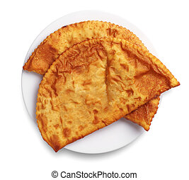 Two tasty pasties in a plate on white background