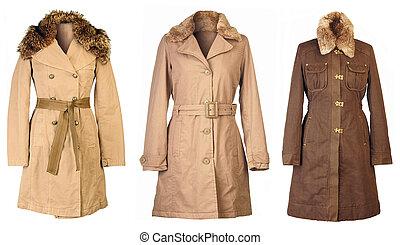 Autumn Coats - Three woolen coats isolated on white...