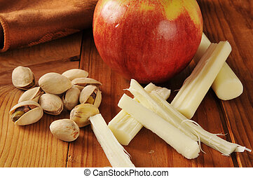 Healthy snack food - Pistachio nuts with an apple and string...