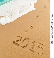2015 and footprints on sand beach