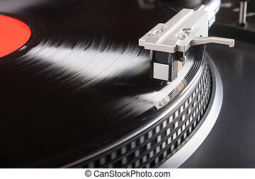 Vintage record player with vinyl record close-up