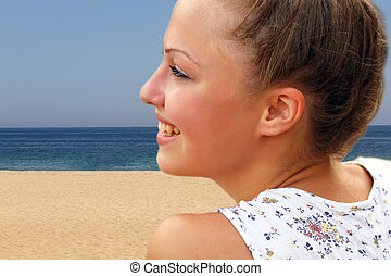 Portrait of beautiful girl on the sea background.