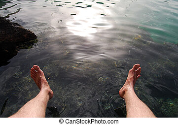 wet feet  - Picture of feet over clear water