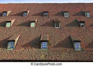 tile roof - old pitched red tile roof with tiny garret...