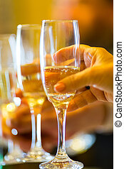 Champagne toast - Celebration toast with champagne at a...