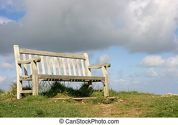 Bench on a hilltop, storm is coming, it\'s about to rain